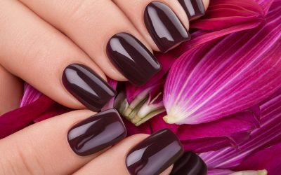 Beautiful nails and flower close-up, great idea for the advertising of cosmetics.